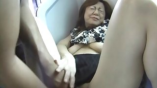 Small tits Japanese moans while getting fingered in public transport