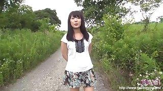 Asian woman is fucked in a field outside