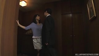 Horny Japanese become man drops on her knees forth suck his immutable dick