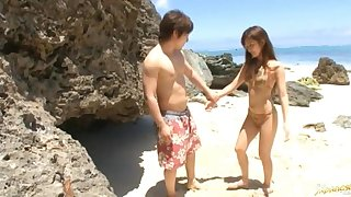 Japanese wife Rio Fujisaki drops on her knees in the air suck a dick by the sea
