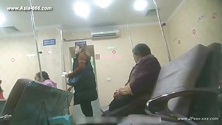 peeping chinese woman through despite the sickbay for an injection.1