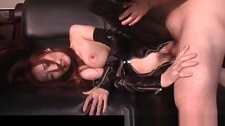 Naff jap mistress in latex banged doggy style out of reach of the sofa