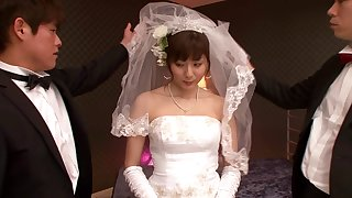 A Japanese bride wears her bridal gown to the fullest extent a finally bouncing on a unearth